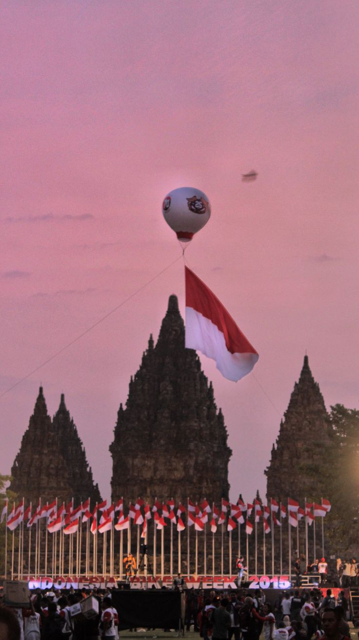 Prambanan Temple, Yogyakarta  #ProudToBeIndonesian That was exact feeling to describe this picture. Indonesia's flag up in the sky with the beautiful scenery of reddish sunset at Prambanan Temple.