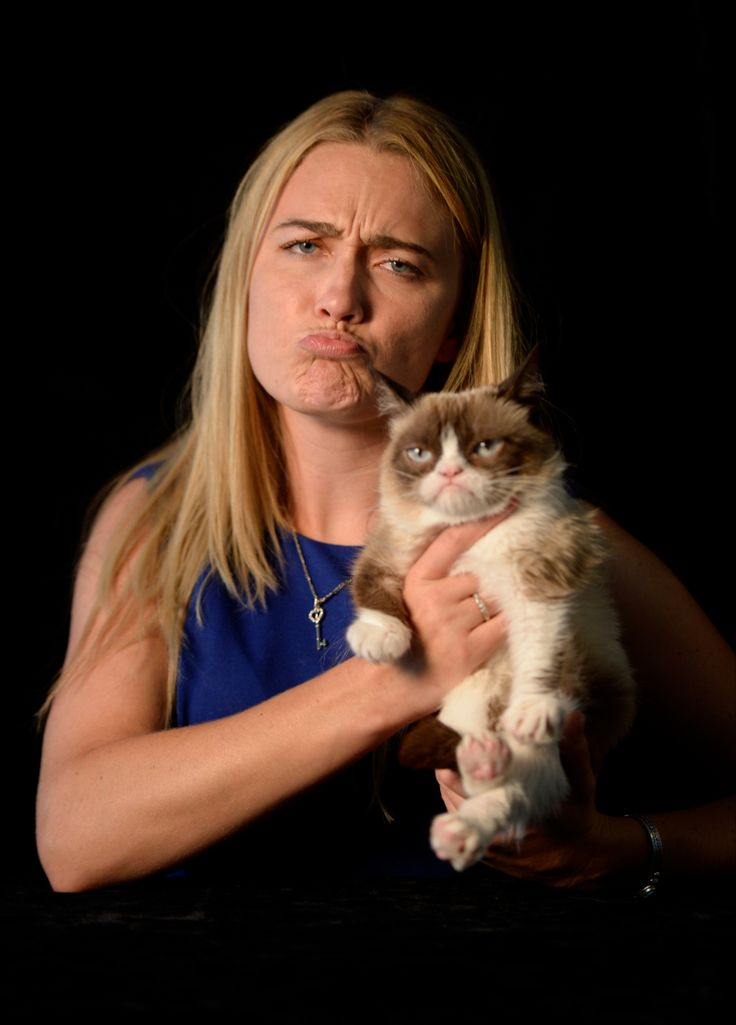 Owner Tabatha Bundesen helped Grumpy pose for the professional photos, and joined the fun. (Robert Deutsch, USA TODAY) - Aug 2014 #GrumpyCat #Tard #TardarSauce / Pinned to the Grumpy Cat board here, http://www.pinterest.com/fairbanksgrafix/tard-the-grumpy-cat/