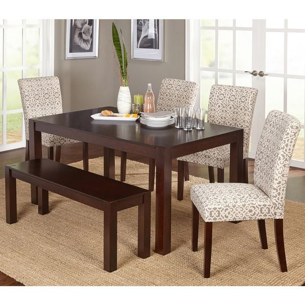 Elevate your dining room with this chic and contemporary six-piece dining set, which adds a stunning look to your existing decor. With your choice of beige or off white with grey print parsons chairs