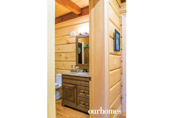 """A rustic vanity draws the eye in this powder room.    See more of this home in """"Fifth Generation Legacy on Muskoka's Moon River"""" from OUR HOMES Muskoka Early Summer 2017: http://www.ourhomes.ca/articles/build/article/fifth-generation-legacy-on-muskokas-moon-river"""