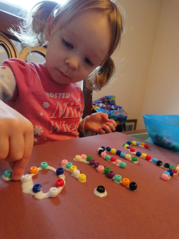 Rainbow Names with beads and glue!  Good for hand/eye coordination, learning letters and colors, spelling, patterns... lots of fun!