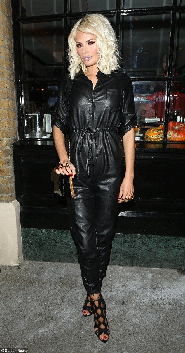 Birthday suit: Chloe Sims covered up in a black pleather jumpsuit as she celebrated her bi...