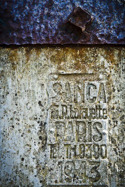 Art photo.  Cutaway of a single man concrete pillbox left at Normandy, France.