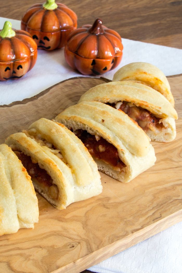 how to make vegetarian calzone mummies stuffed with chickpeas tomato sauce and cheeses for halloween
