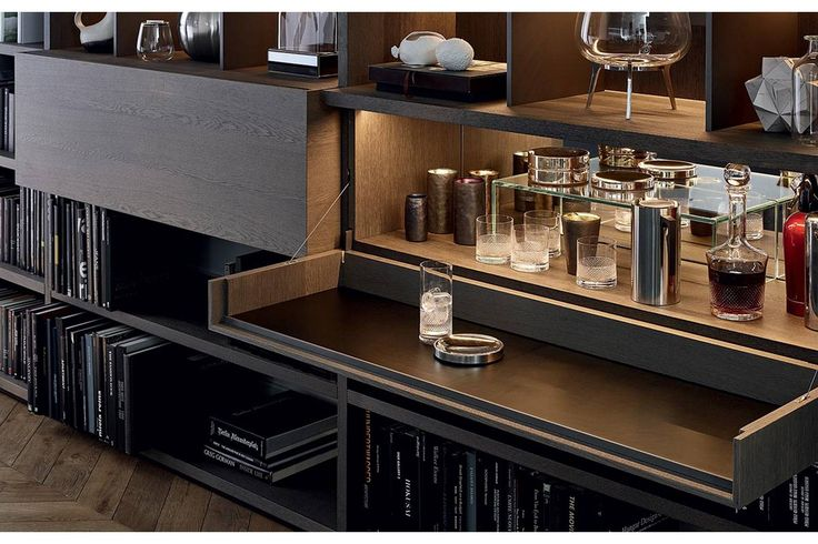 Poliform's Wall System is the most sophisticated of wall units, allowing for a wide range of design solutions for a library, entertainment centre or simply an elegant bookcase. The exceptionally versatile and aesthetically original system is completely freestanding and adapts to all architectural environments.