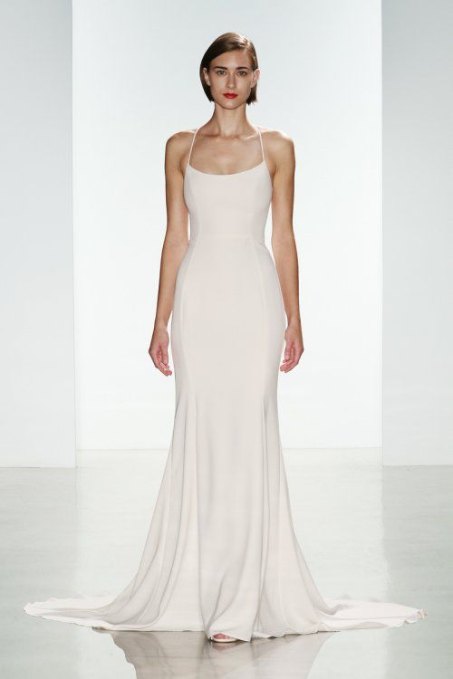Slim crepe bridal gown with ballerina neckline and racerback from Nouvelle Amsale with covered buttons over zipper and continue on train. Available in Ivory.