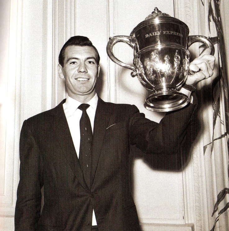 Fulham and England captain Johnny Haynes holds aloft the cup after receiving the Sportsman of the Year trophy at the Savoy Hotel, London - 10 November 1961