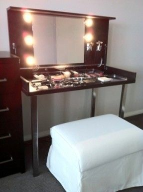 Hideaway Dressing Table USING Ikea's VIKA VEINE table. In this image, the table top is flipped up to reveal a mirror, lights, and make up storage. I want to make one for my closet!