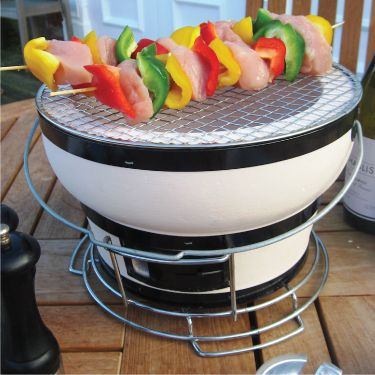 """Fire Sense HotSpot Round Table Top Yakatori Charcoal Grill""    •High fired ceramic clay construction  •Adjustable ventilation  •Compact size for table top grilling  •Authentic Japanese street grill design"