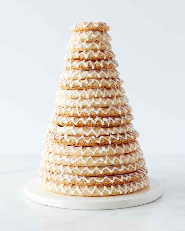 Kransekake is a showstopping Scandinavian cake served on special occasions such as weddings or Christmas. Martha made this recipe on episode 703 of Martha Bakes.