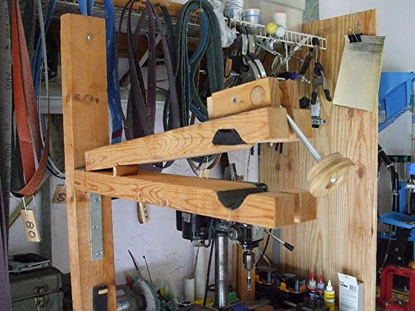 We continue to receive great DIY bike repair stand ideas from our readers. This time Mike went MacGyver on his garage workbench and created a repair stand for less than $10. All text and pictures below are credited to Mike and the original pictures can be found via his photobucket account. If you have a created a maintenance stand feel free to email us. For a summary of all the DIY stands featured on Bike Hacks click here. - - - - - - - - Faced with a need to elevate my bicycle for a bit of…