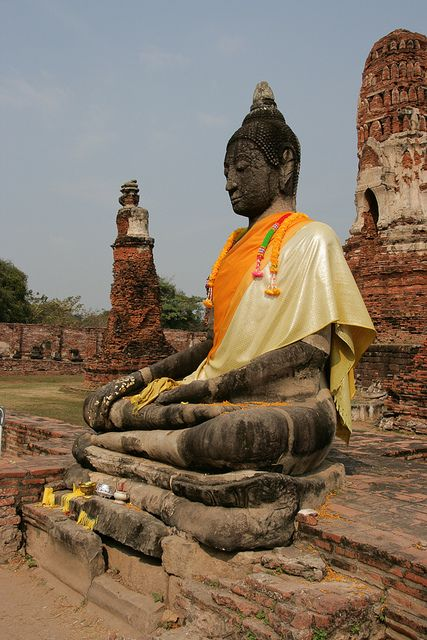Buddha in Ayutthaya, Thailand. Located in the valley of the Chao Phraya River, the city was founded in 1350 by King U Thong, who went there to escape a smallpox outbreak.