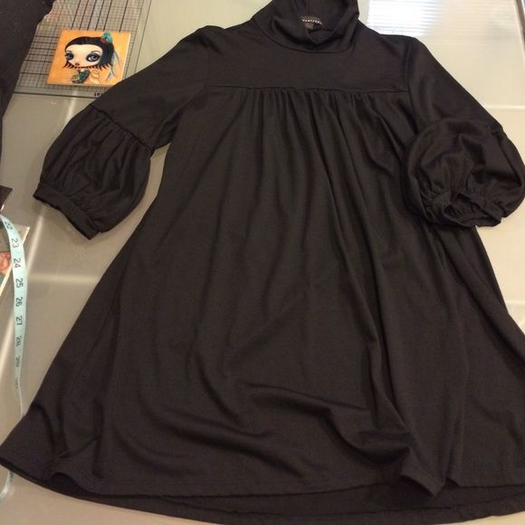 """New Black Smock Top New. Never worn. Black Forever 21 smock top. Approx. 27"""" long. 50% Rayon/42% Polyester/8% Spandex. I actually just washed it because I got a little foundation on the collar when I tried it on. It's off, like new again. Forever 21 Tops Blouses"""