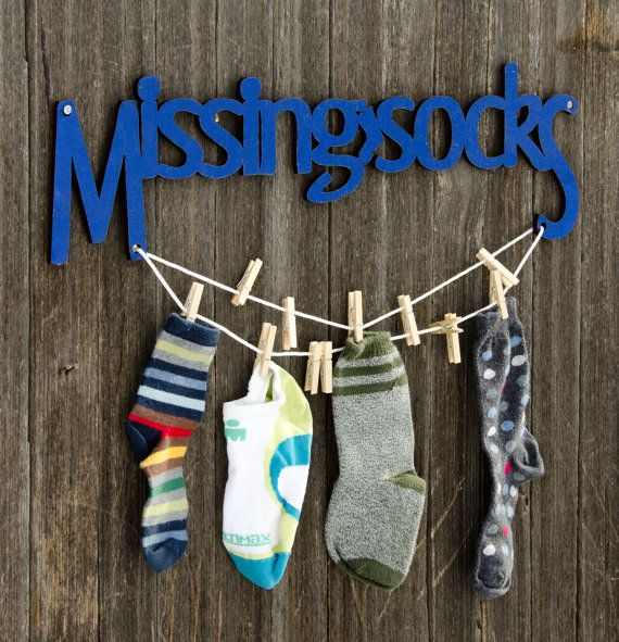missing socks sign with clothes pins.
