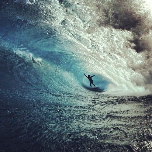 Surfer deep in a barrel