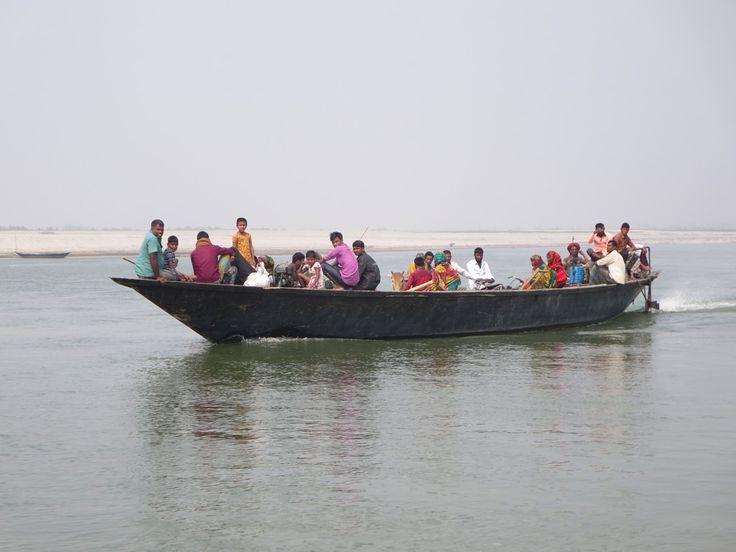 This boatload of Bangladeshis is coming from a chars (sandbank island) in the Jamuna River east of Bogra.
