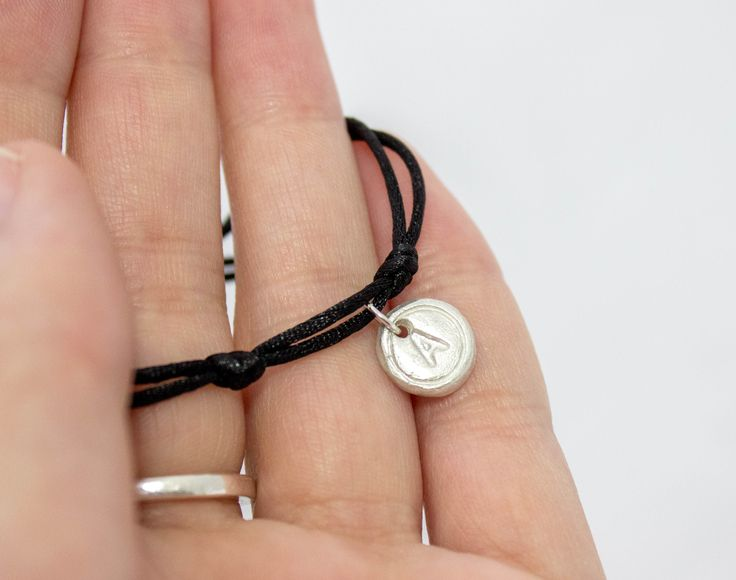 This typewriter bracelet is a perfect little silver charm bracelet that you can personalise. Customise this bracelet with the letter of your choice and gift as a perfect personalised jewellery gift. Bespoke Bracelets makes its supper easy for you customise the colour and the charms added to your bracelets.