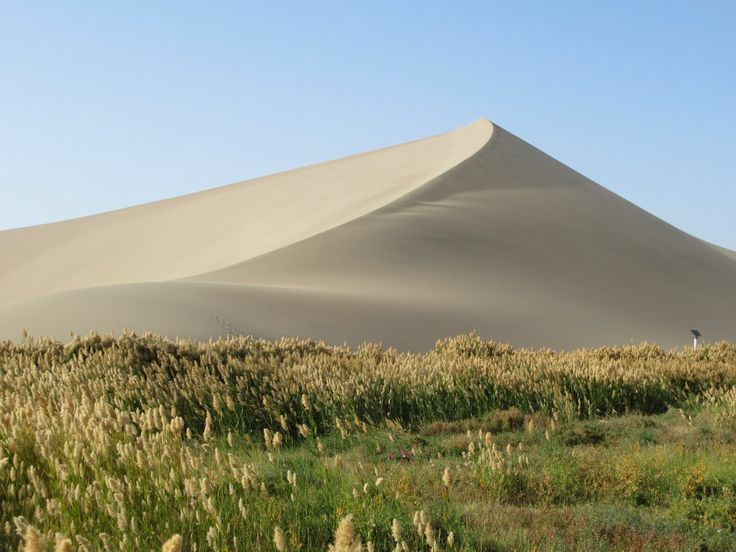 This pyramid-shaped dune is just south of Dunhuang, Gansu, China, at the Mingsha Sand Dunes.