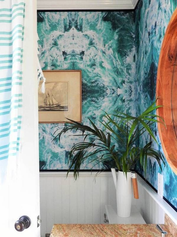 a super beachy bathroom yes that is wave wallpaper