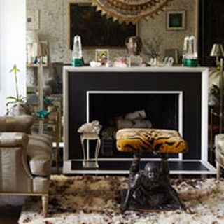 This traditional living room has an intriguing modern element in the fireplace. Black & white contrast.