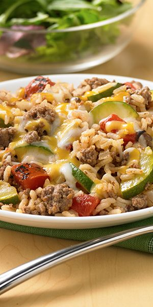 Ground beef, zucchini, fire roasted tomatoes and rice cooked together for an easy one skillet entrée