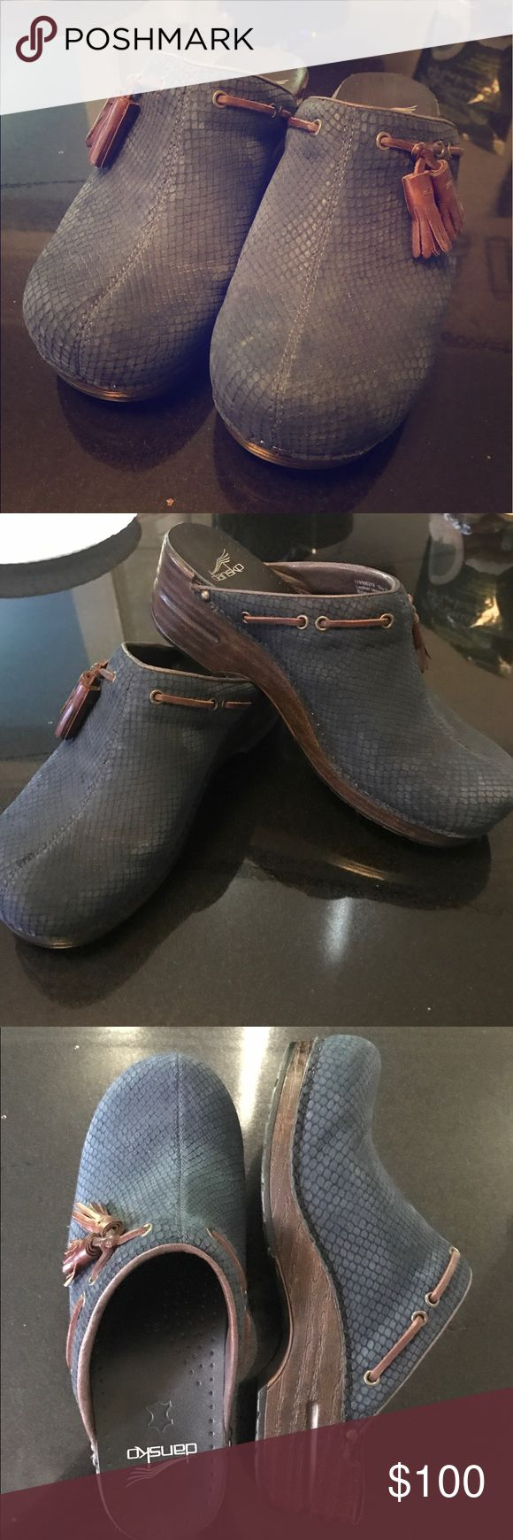 Dansko navy blue textured clogs Dansko navy blue women's heeled clogs with brown leather tassels. Barely worn, clean soles and no wear. Dansko Shoes Mules & Clogs