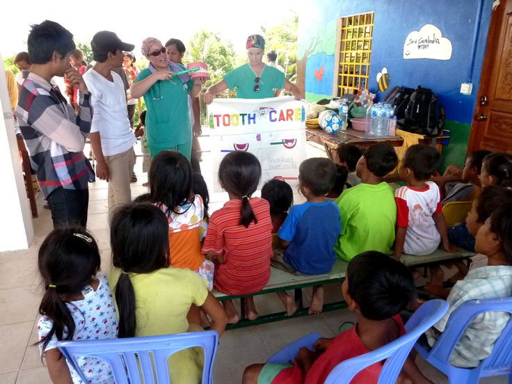 Nurses teaching dental hygiene at a medical camp in partnership with Project Cornerstone in Cambodia.
