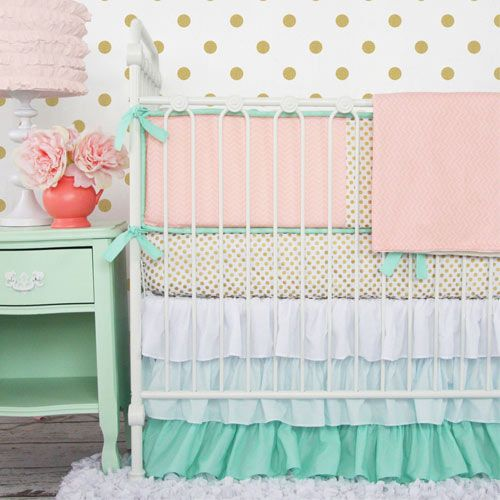 baby room ideas. polka dot wall, gold pink and mint colors