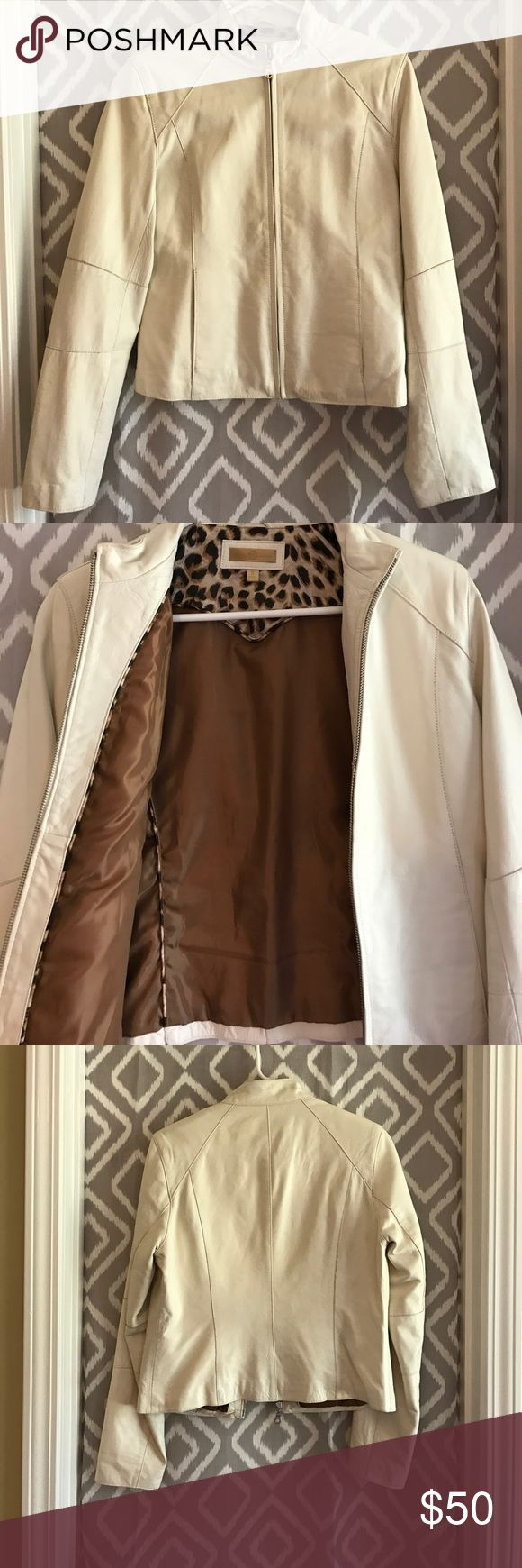 Wilsons leather ivory jacket Size S Wilsons Leather ivory jacket with leopard detail on inside. Worn only a few times, in good condition. Just needs a light wipe down with leather cleaner. Wilsons Leather Jackets & Coats Blazers