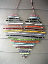 Any shape, any colour, anything found out side... a class of kids could get really creative with this hanging 3-d art idea.