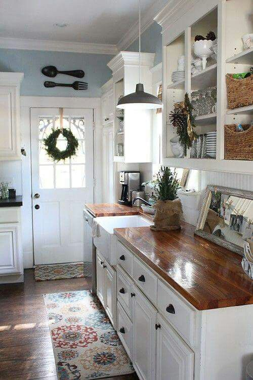 Love the blue walls, white cabinets and wood countertops!