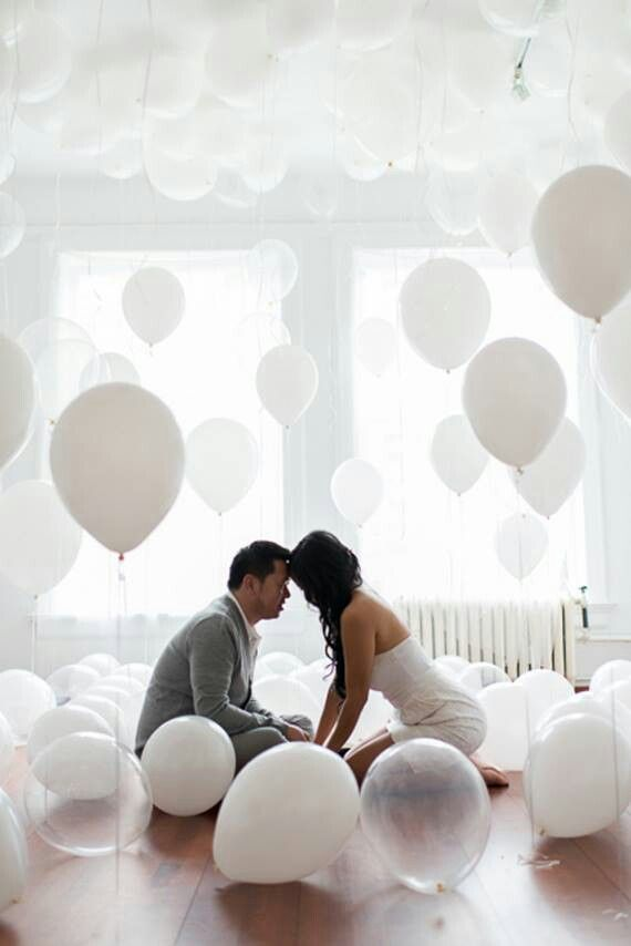 Balloons galore...all white/clear...ONE large red?