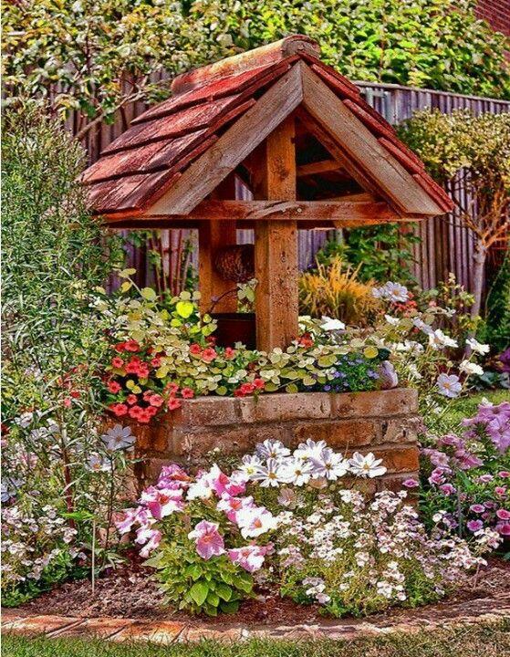 Wensput vol met bloemen.
