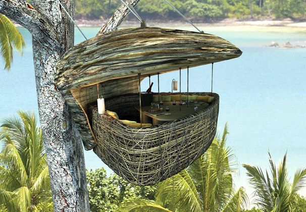 Suspended tree pod dining in Thailand
