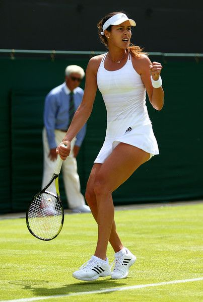 Ana Ivanovic Photos - Ana Ivanovic of Serbia in action in her Ladies's Singles first round match against Yi-Fan Xu of China during day one of the Wimbledon Lawn Tennis Championships at the All England Lawn Tennis and Croquet Club on June 29, 2015 in London, England. - Day One: The Championships - Wimbledon 2015