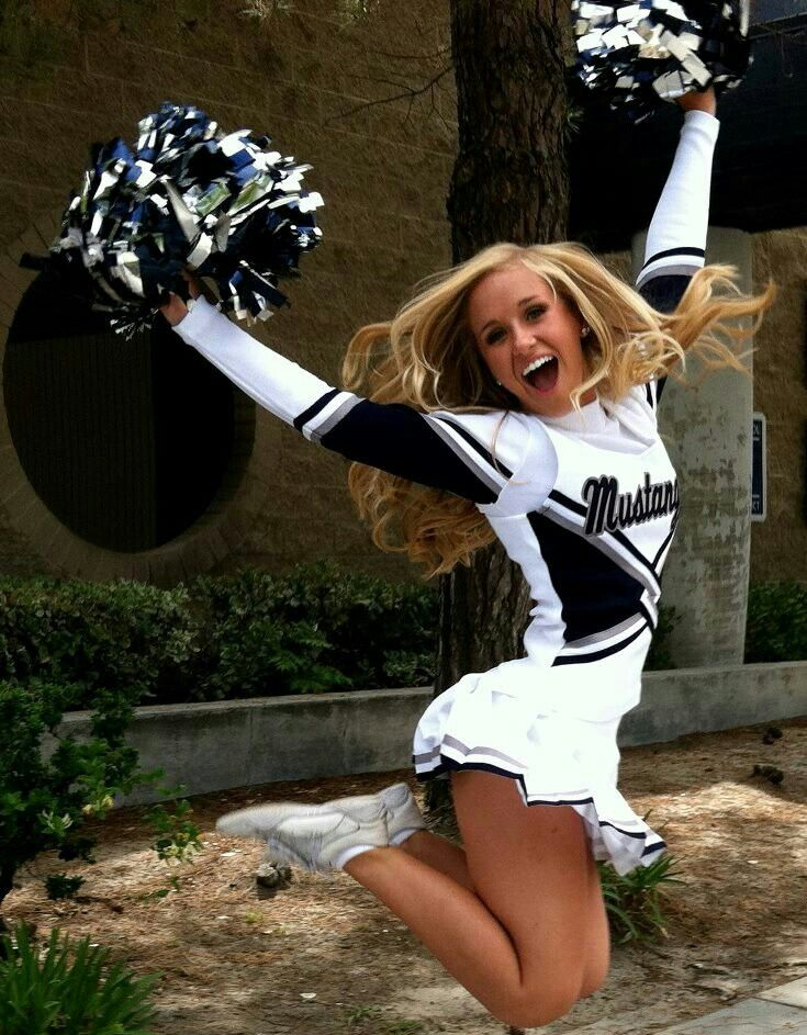 Cheerleader jumping in the air, great photography, action, smiling, happy pom poms, cheerleader CHEER #KyFun