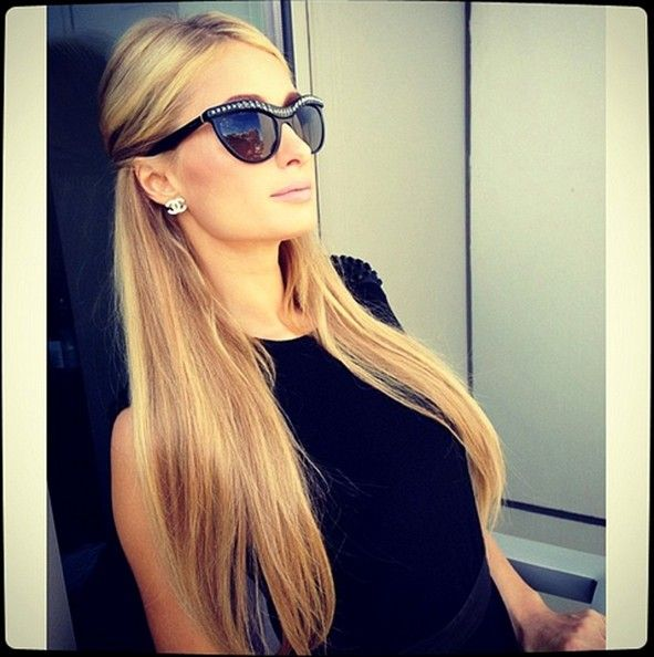 Paris Hilton...for best shades!! She always has on a pair that flatter her face:) and some of her outfits are cute! (About 25%!!;P)