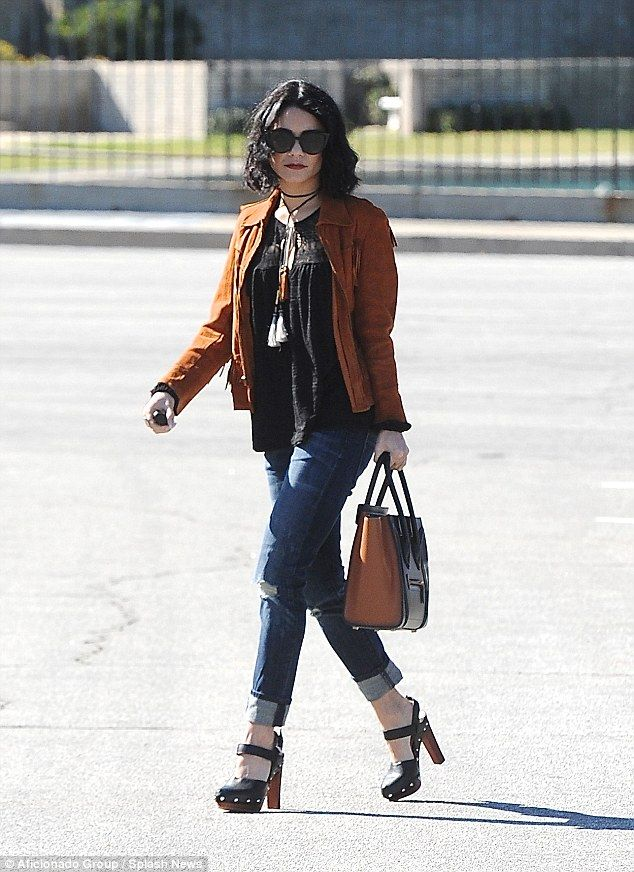 Somber: Vanessa Hudgens makes funeral preparations in Burbank on Tuesday...