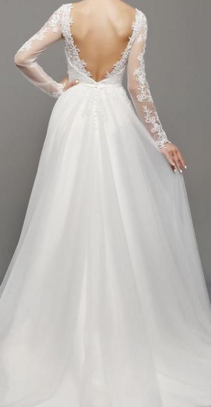 BB1282. So pretty! With lace sleeves, soft tulle skirt and open V back. Available in store now. Come and visit us in Albany village on the North Shore. See more on http://bridalandball.co.nz/wedding-gowns/