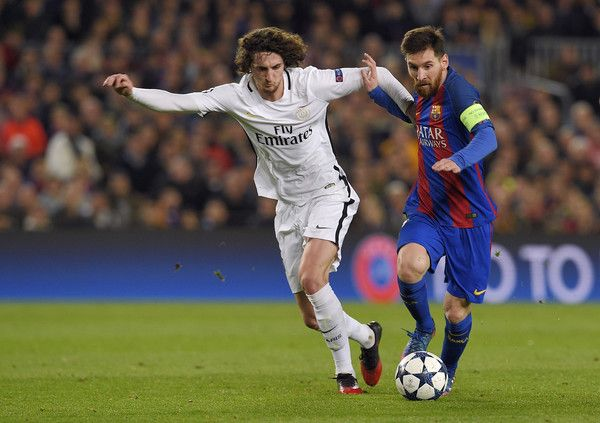 Barcelona's Argentinian forward Lionel Messi (R) vies with Paris Saint-Germain's midfielder Adrien Rabiot during the UEFA Champions League round of 16 second leg football match FC Barcelona vs Paris Saint-Germain FC at the Camp Nou stadium in Barcelona on March 8, 2017. / AFP PHOTO / LLUIS GENE