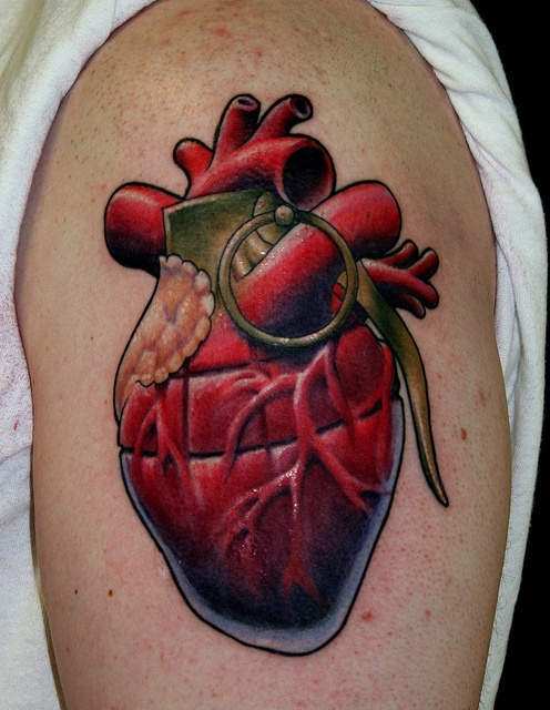 heart grenade tattoo on the arm Damien Lugo @ Southern Son Tattoo by fleshmanifestd, via Flickr