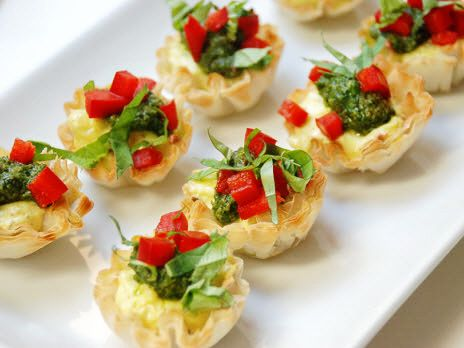 These delicious little bites are a mouthful of delight and perfect to have for an appetizer. They have a nice and creamy filling with the combination of the cream cheese and garlic herb goat cheese. Top them with pesto, sweet bell pepper and basil and enjoy!