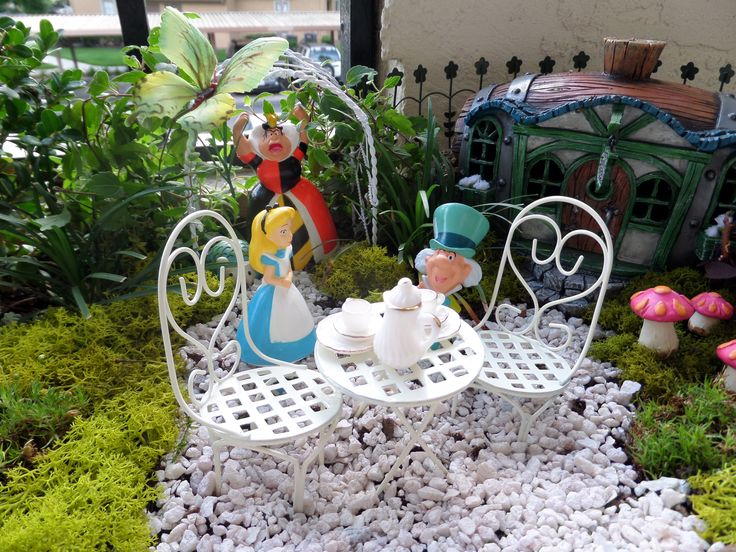 alice in wonderland garden on my patio fairy gardens pinterest tea parties miniature and. Black Bedroom Furniture Sets. Home Design Ideas