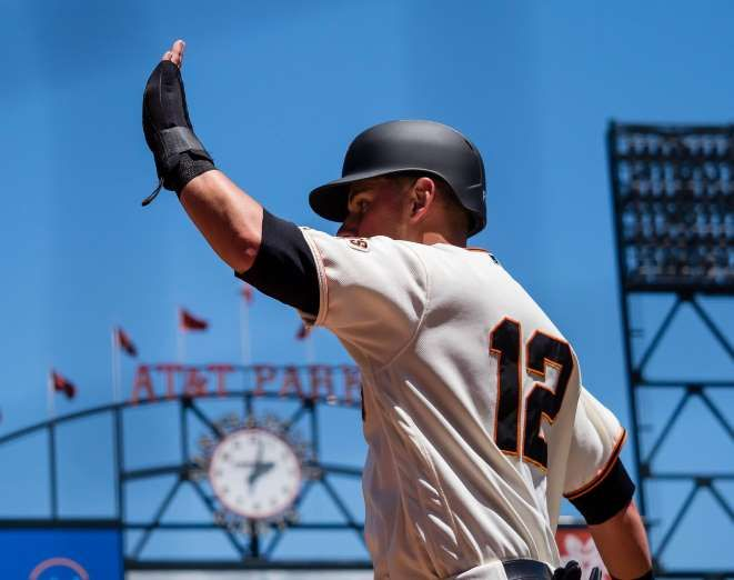HIGH TIME:   San Francisco Giants second baseman Joe Panik high fives a teammate after scoring a run against the Colorado Rockies during the fourth inning on June 28 at AT&T Park in San Francisco. The Giants won 5-3.