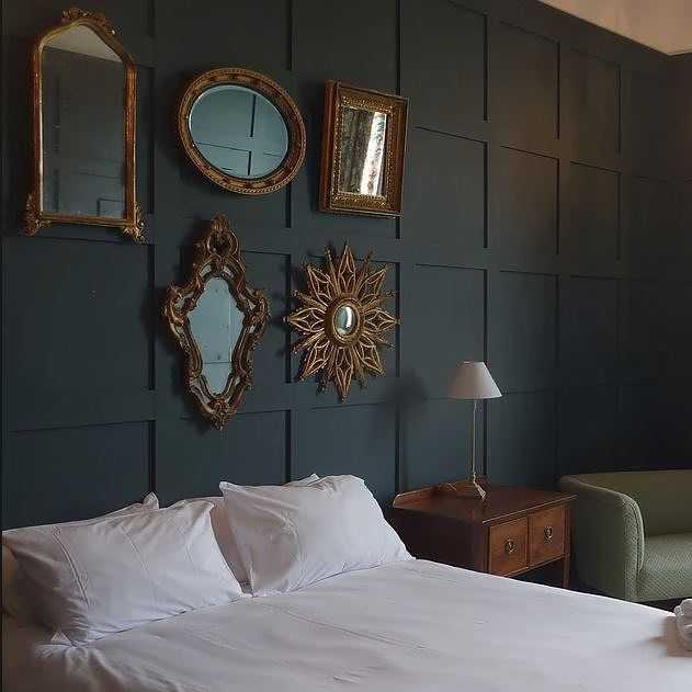 Our Green Bedroom paneling is painted in Newburg Green by Benjamin Moore & looks wonderful with crisp white linen and gold mirrors