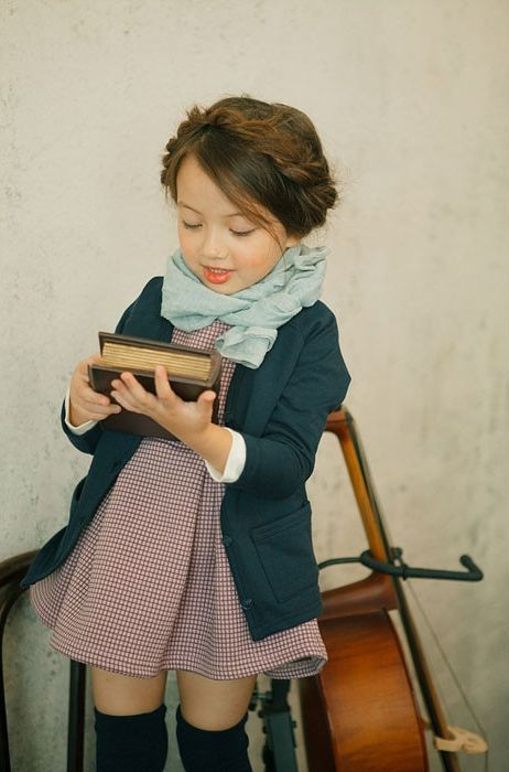This little girl is obviously being exposed to books and classical music. Both can have very positive effects on brain development and stimulation.