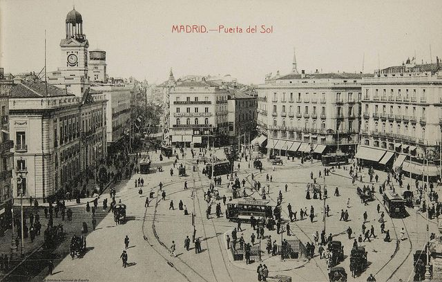 """""""Madrid - Puerta del Sol [1915?],"""" by Biblioteca Nacional de España, via Flickr -- Click through for a photostream """"Postales de Madrid"""" from the National Library of Spain for (currently) 42 historic views of Madrid in the early 20th century."""