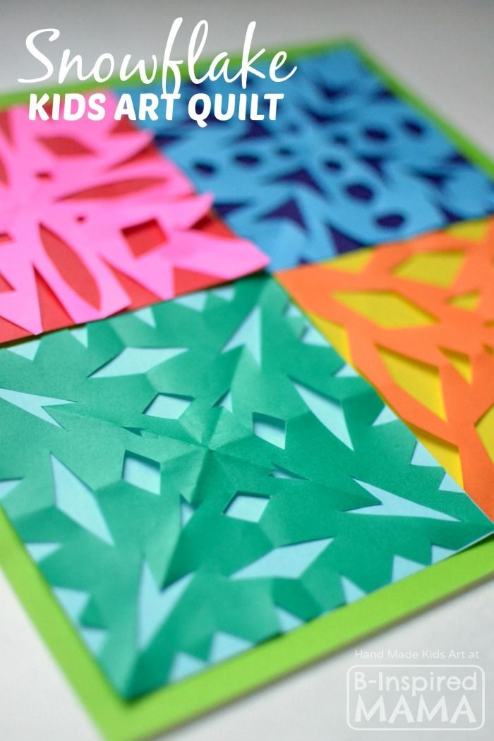 A Kids Art Quilt Full of Paper Snowflakes - B-Inspired Mama | winter activity | kids craft | winter craft | snowflake craft | cutting snowflakes | kids art