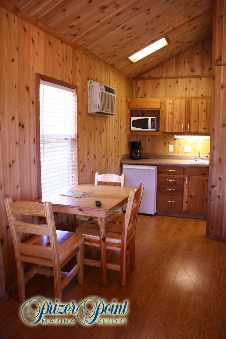 Small Kitchenette in KOA Suite with microwave, coffee maker, dorm size refrigerator, & sink complete with a  small eating area @Mary Dunbar in Cadiz, KY