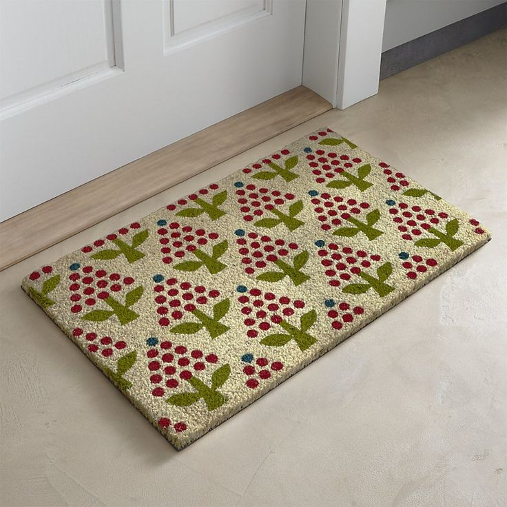 Shop Holiday Topiary Coir Doormat.  Designed by Neisha Crossland, this friendly doormat repeats Christmas trees, berries and topiaries in a jolly pattern inspired by Scandinavian folk art.